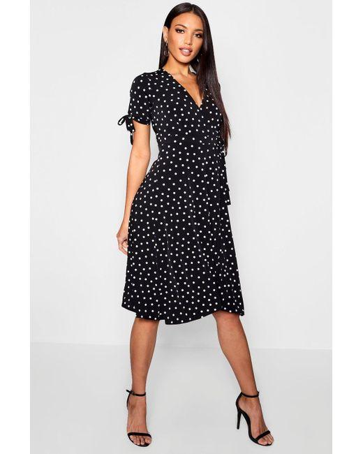 c6d64c4f4483 Boohoo - Black Polka Dot Midi Wrap Dress - Lyst ...