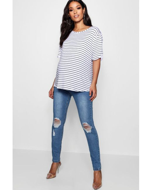 02538fce21043 Boohoo - Blue Maternity Over The Bump Distressed Knee Skinny Jeans - Lyst  ...