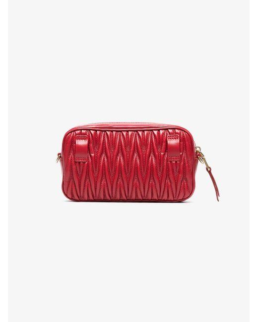 9b88a879fb8 ... Miu Miu - Red Matelassé Leather Belt Bag - Lyst ...