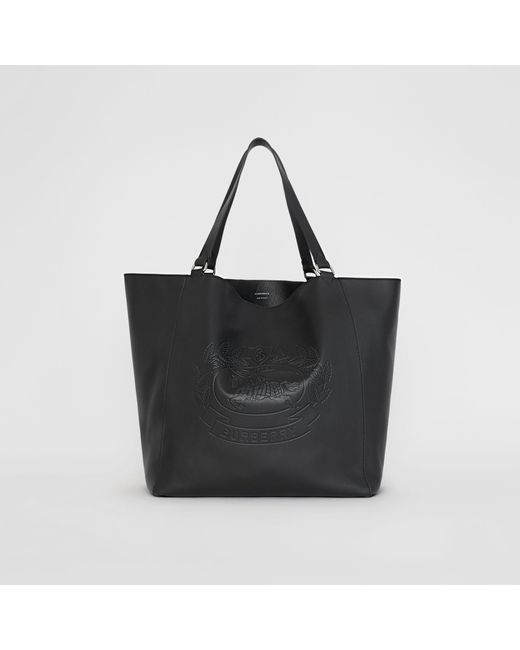 ba832beb845 ... Burberry - Black Large Embossed Crest Bonded Leather Tote for Men - Lyst  ... Lyst - Saint Laurent ...