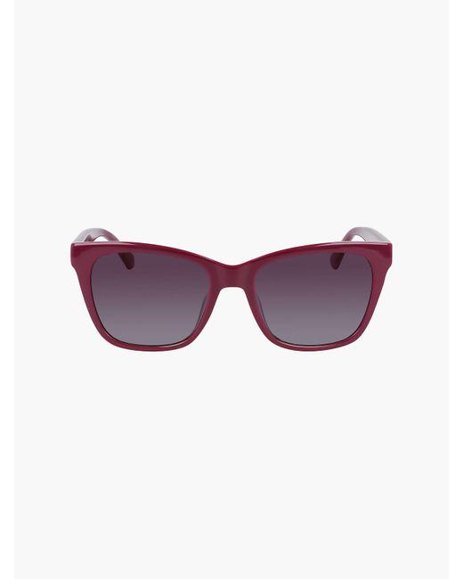 Lunettes de soleil yeux de chat CKJ21618S Calvin Klein en coloris Purple