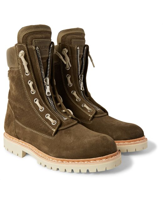 Some preferred Balmain boots mens category include the Balmain black quilted active buckle high top sneakers, the Balmain black army ranger zip boots, and the Balmain Black Artemis Boots. The 'Balmainian Army' was a phrase coined by fashion enthusiasts to describe celebrities and other public figures who are loyal fans of the brand.