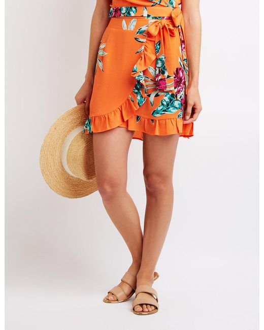49932ca7c8a Lyst - Charlotte Russe Floral Wrap Skirt in Orange - Save 43.75%