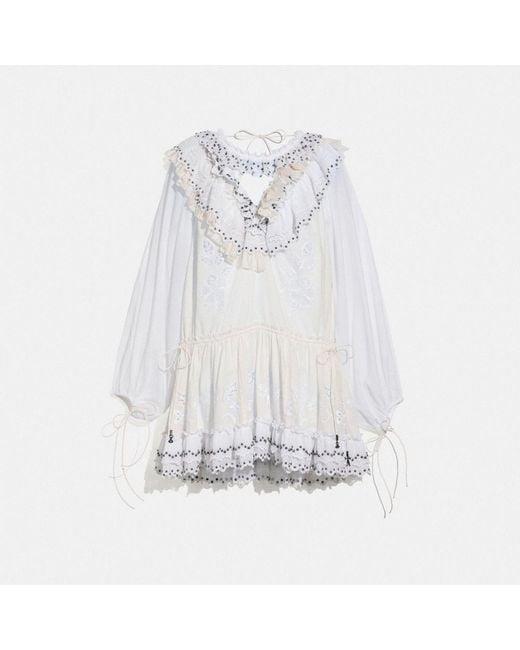 COACH Minivestido romántico con tachuelas de mujer de color blanco