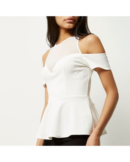 White Mesh Peplum Cut Out Romper; Sku # White Mesh Peplum Cut Out Romper. Regular Price: $ Flawless babe! A gorgeous romper with a see through mesh top bodice and square pattern. Features a flattering pointed stretch knit peplum bottom with a back cut out. Has a back zipper closure and flared silhouette.