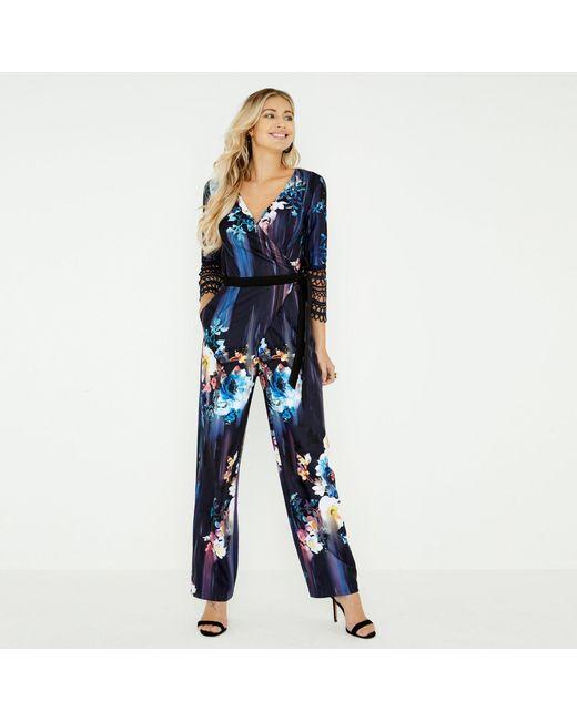 14e280a18a Little Mistress - Blue Navy Viola Floral Mock Wrap Jumpsuit - Lyst ...