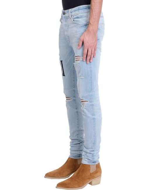Amiri Blue Embrodered Ami Jeans In Cyan Denim for men