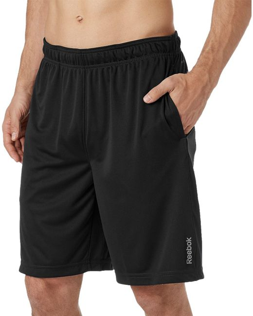 Reebok - Black Solid Performance Shorts for Men - Lyst