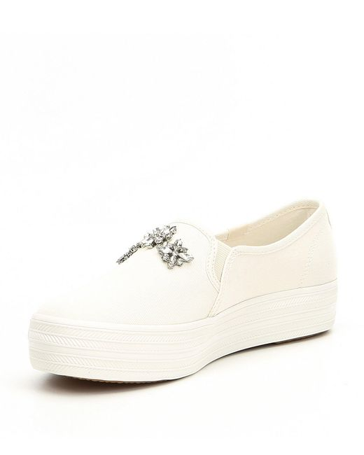 5c21c4434ad ... Kate Spade - Natural Triple Decker Stone Embellished Sneakers - Lyst