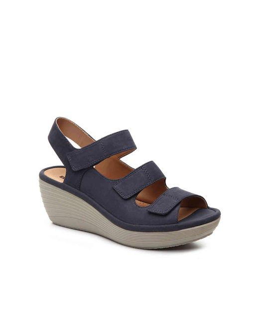 81209d7055f Clarks - Blue Reedly Juno Wedge Sandal - Lyst ...