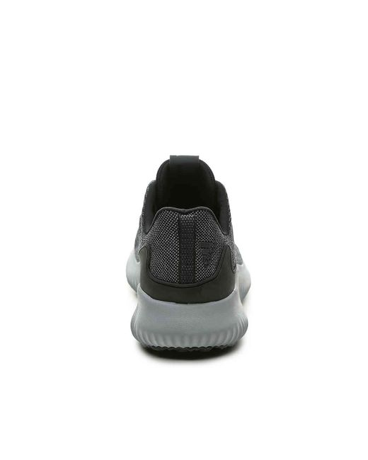lyst adidas alpha salta performance scarpa da corsa in nero per gli uomini.