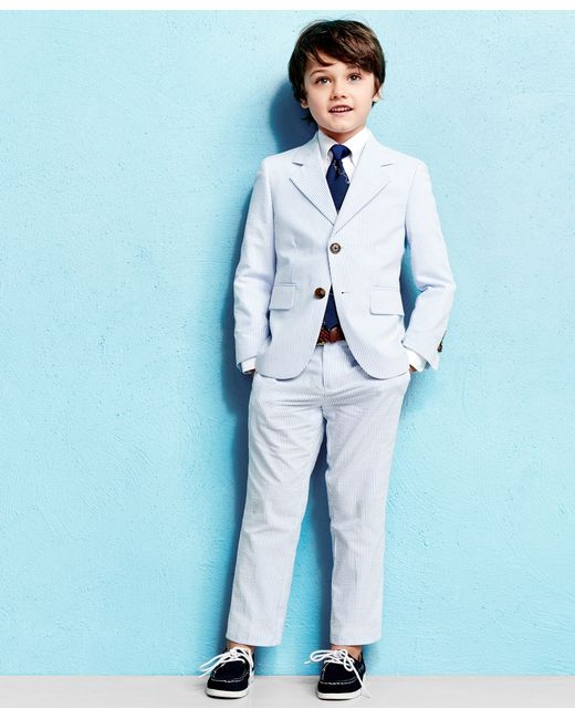 Light-blue and white cotton-seersucker Notch lapels, functioning buttoned cuffs, chest welt pocket, two front patch pockets, two internal pockets Three button fastening.