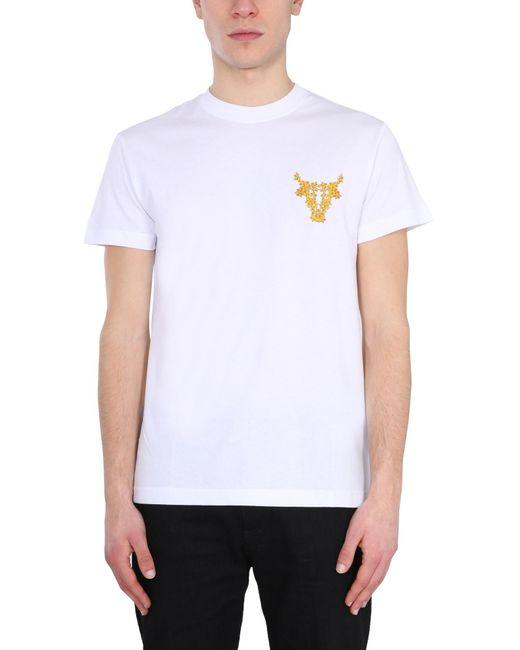 T-SHIRT IN COTONE CON STAMPA TORO BAROCCO di Versace Jeans in White da Uomo