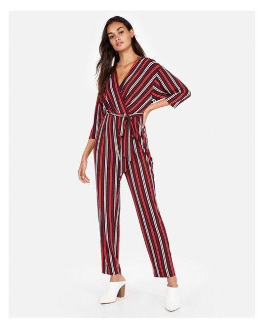 bf51e386681 Lyst - Express Stripe Tie-waist Surplice Jumpsuit in Red - Save 17%