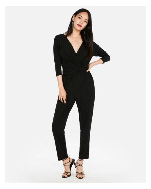 4a6f7cc8da9 Express Petite Long Sleeve Twist Front Jumpsuit in Black - Lyst