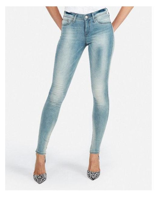 cea1fa005c0 Lyst - Express Mid Rise Faded Extreme Stretch Jeggings