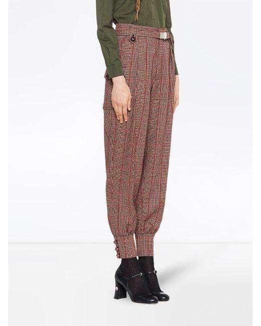 Pantalon fuselé à carreaux Miu Miu en coloris Red
