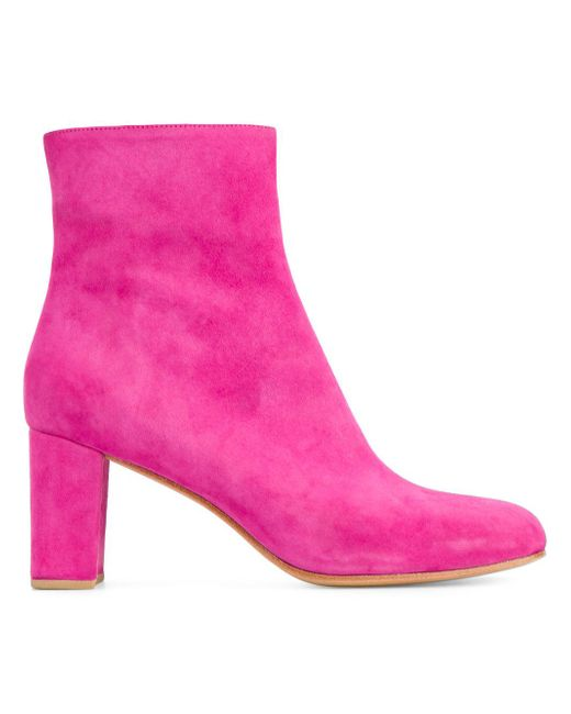 Pink boots Ankle Booties Suede ankle boots Bootie/ Boots Suede booties Mens suede boots Short ankle boots Bootie heels Block heel sandals Forward A fashion look from February featuring short-sleeve shirt, high waisted stretch jeans and high heel bootie.