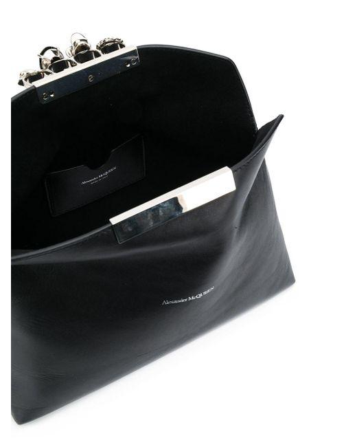 Bolso de mano Skull con cuatro anillos Alexander McQueen de color Black