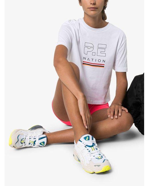 T-shirt crop à logo imprimé P.E Nation en coloris White