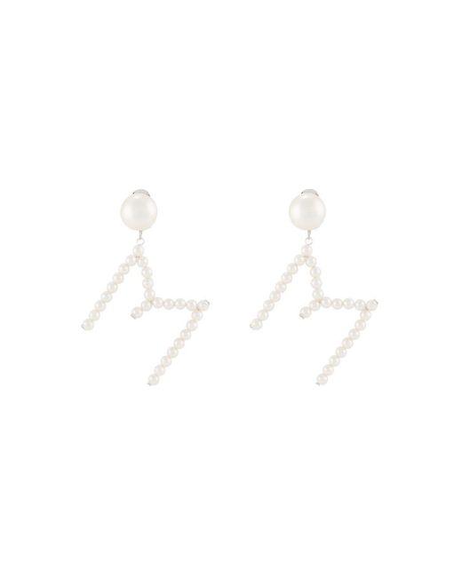 Boucles d'oreille M pendantes à ornements en perle Moschino en coloris White