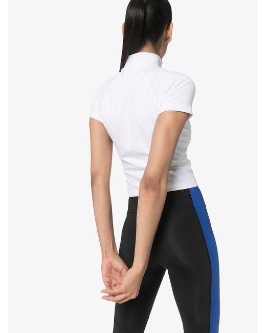 Polo Ralph Lauren Top deportivo con logo estampado de mujer de color blanco
