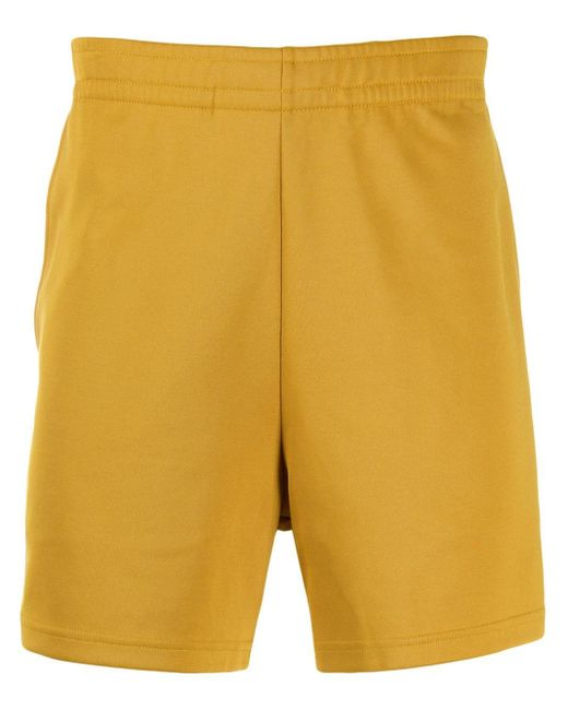 Acne Yellow Face Pack Track Shorts