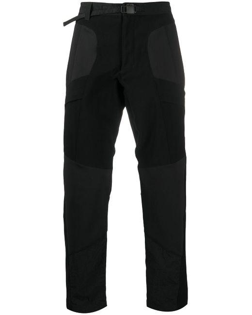 Pantaloni slim con pannelli a contrasto di White Mountaineering in Black da Uomo