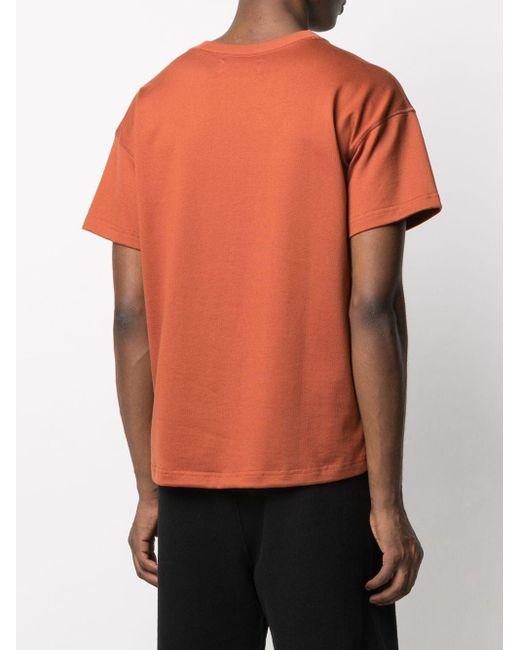 T-shirt con stampa di Styland in Orange