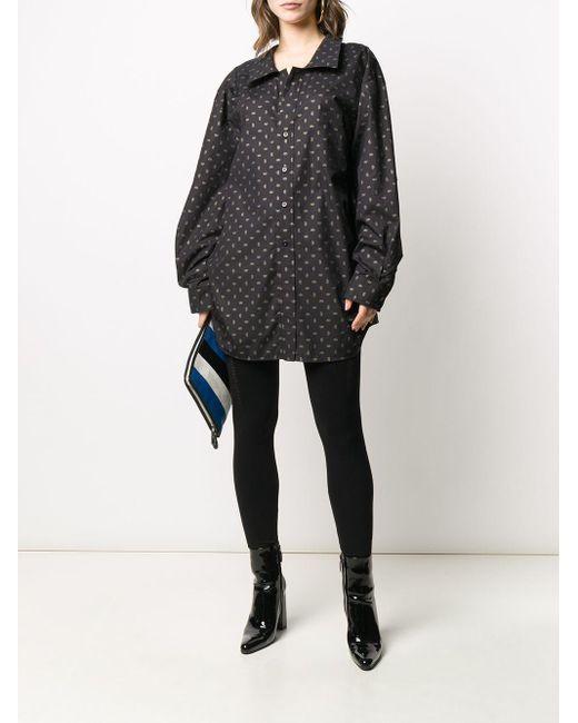 Legging à détail perforé Balenciaga en coloris Black