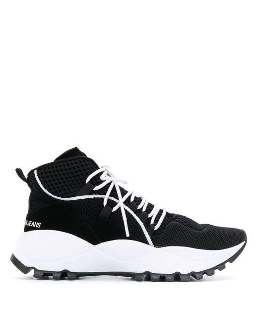 Calvin Klein Zapatillas con paneles de malla de mujer de color negro