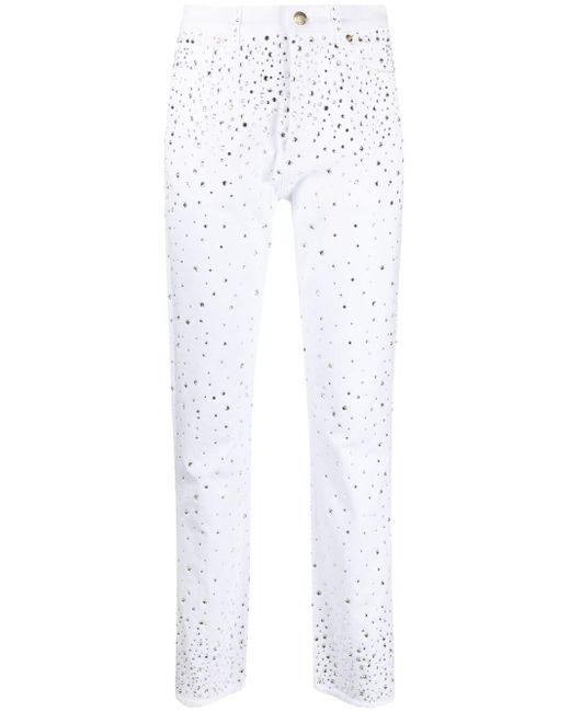 Vaqueros slim con detalles de strass Alexandre Vauthier de color White