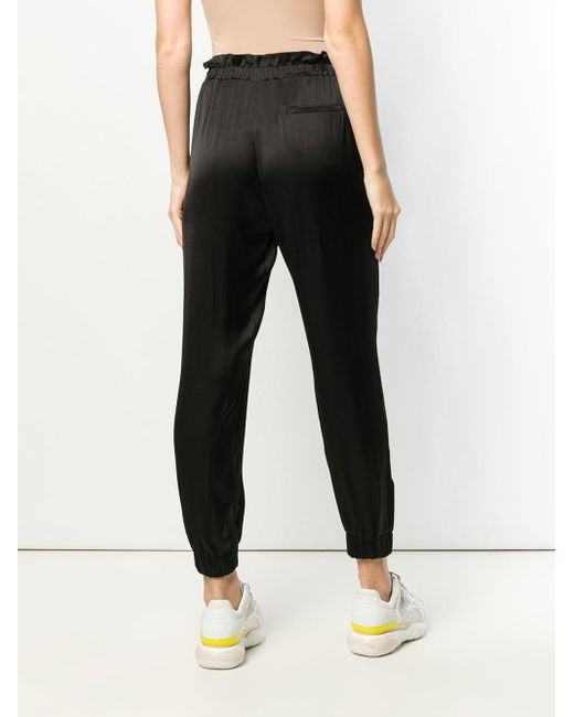 Pantalon fuselé satiné Pinko en coloris Black