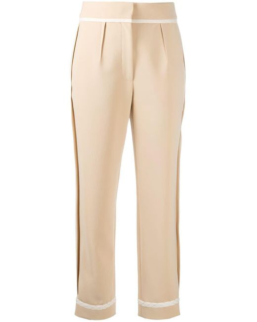 Pantaloni sartoriali a vita alta di Moschino in Natural