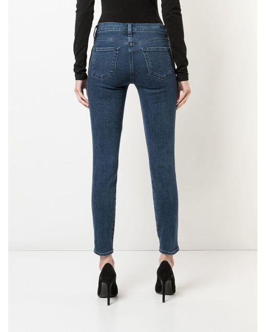 J Brand Blue Skinny-Jeans mit dekorativen Knöpfen