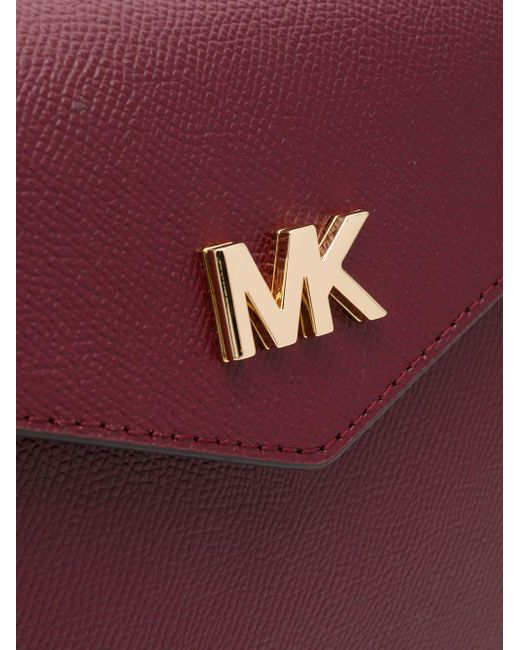 87d337e59eb759 Michael Kors Large Crossgrain Leather Crossbody Clutch in Red - Save ...