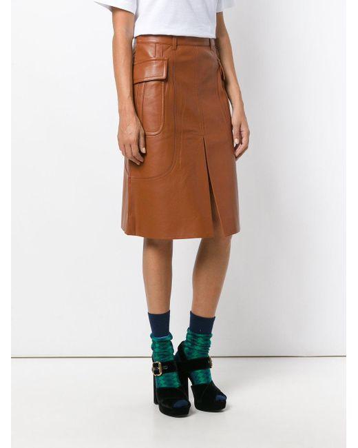 She....? brown straight skirt she