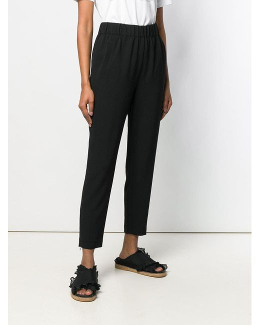 Pantalones de corte tapered Ganni de color Black