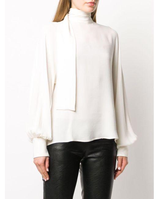Blusa a collo alto di Valentino in White