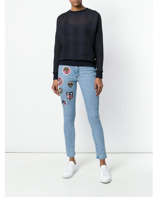 Patched cropped skinny jeans Mr & Mrs Italy en coloris Blue