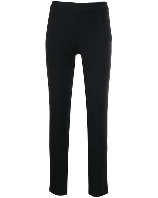 Moschino Pantalones pitillo de talle alto de mujer de color negro