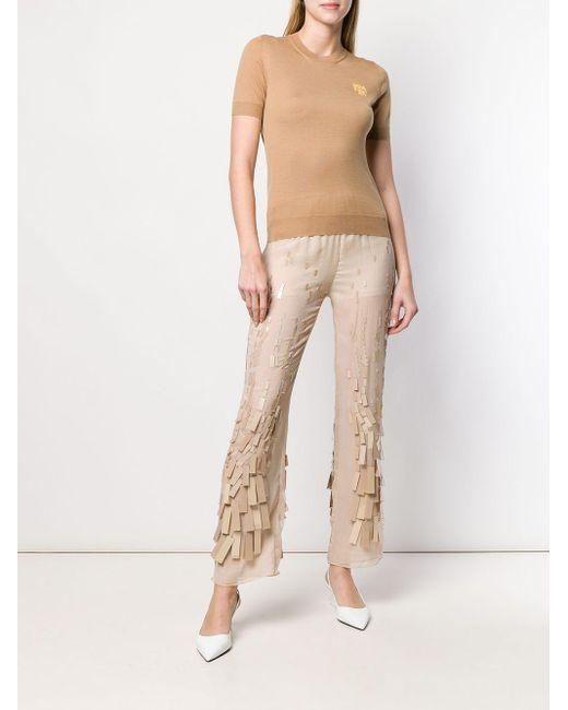 Pantaloni con applicazioni di Prada in Natural
