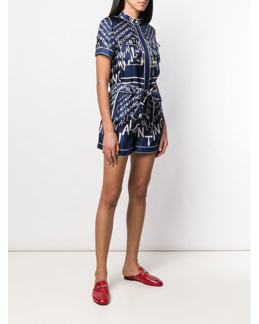 e6e1cd52ad ... Valentino - Blue Printed Silk-twill Playsuit - Lyst ...