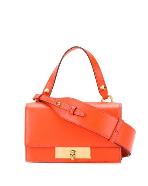 Bolso mini con detalle de calavera Alexander McQueen de color Orange