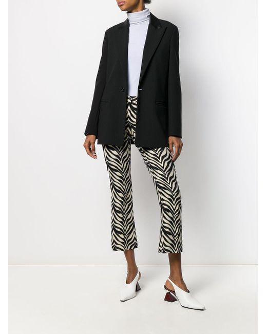 Pantalon crop à motif zébré PT01 en coloris Black