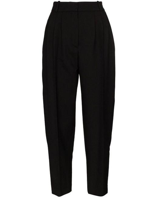 Pantaloni affusolati con pieghe di Alexander McQueen in Black