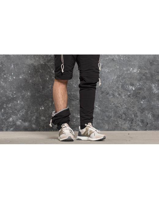 Lyst adidas originali adidas giorno un vento pantaloni neri in nero per gli uomini.