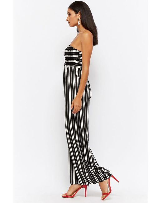 801dc1eacc2 ... Forever 21 - Black Women s Variegated Stripe Strapless Jumpsuit - Lyst