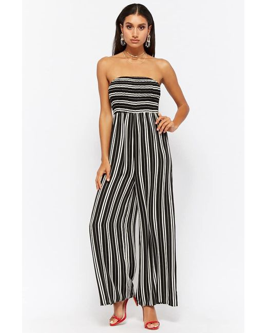 1cdf5bcbc6d Lyst - Forever 21 Women s Variegated Stripe Strapless Jumpsuit in Black