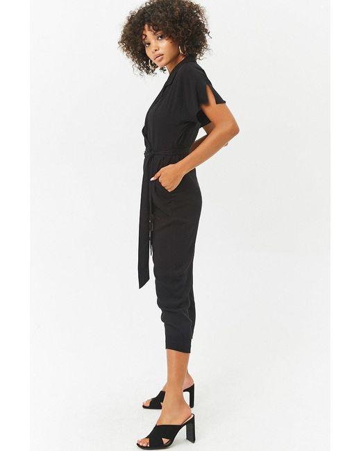 eafc47541b2b ... Forever 21 - Black Women s Plunging Surplice Dolman Sleeve Jumpsuit -  Lyst